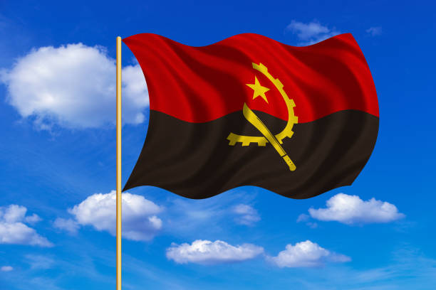Flag of Angola waving on blue sky background vector art illustration