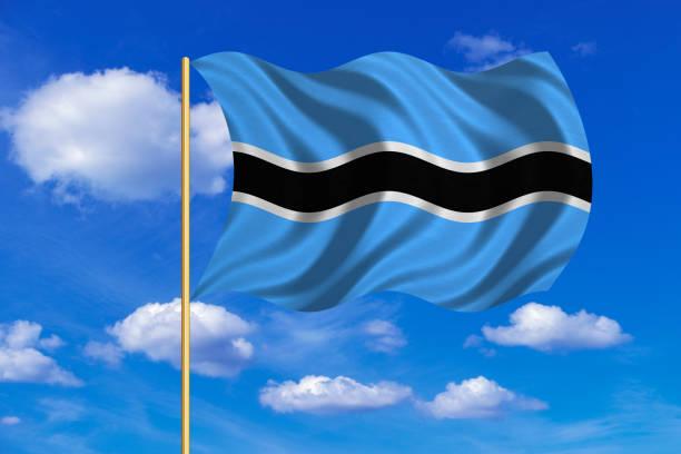 Flag of Botswana waving on blue sky background vector art illustration