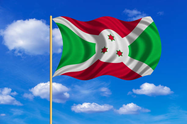 Flag of Burundi waving on blue sky background vector art illustration