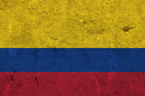 Flag of Colombia on weathered concrete