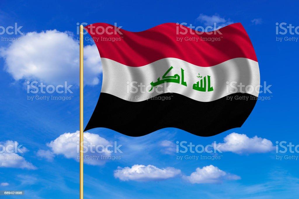 Flag of Iraq waving on blue sky background vector art illustration