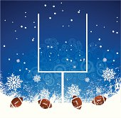 Football balls and goal in snow