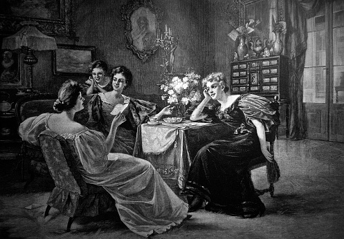 Four young women talk in the living room - 1896