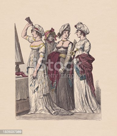 istock French-German costumes (1802-1804), hand-colored wood engraving, published ca. 1880 1325037389