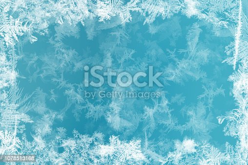 istock Frost patterns on frozen window as a symbol of Christmas wonder. Christmas or New year background 1078513168