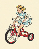 Girl Riding a Tricycle