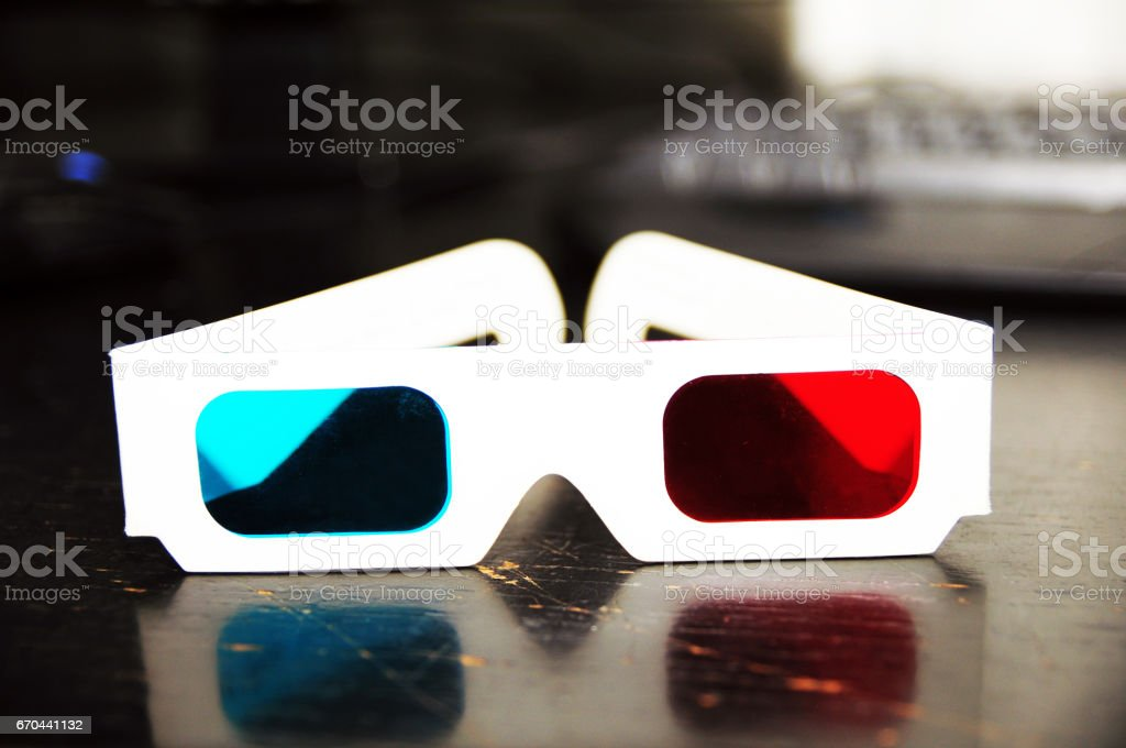 3D glasses with computer keyboard in background vector art illustration