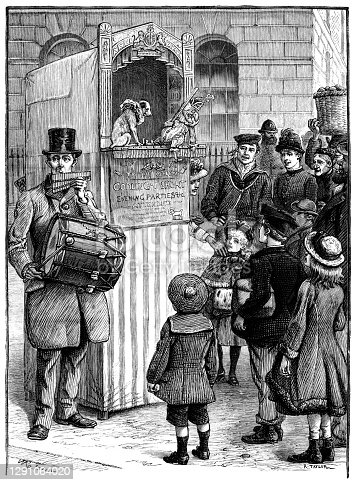 Gleeful audience watching a Victorian Punch and Judy show