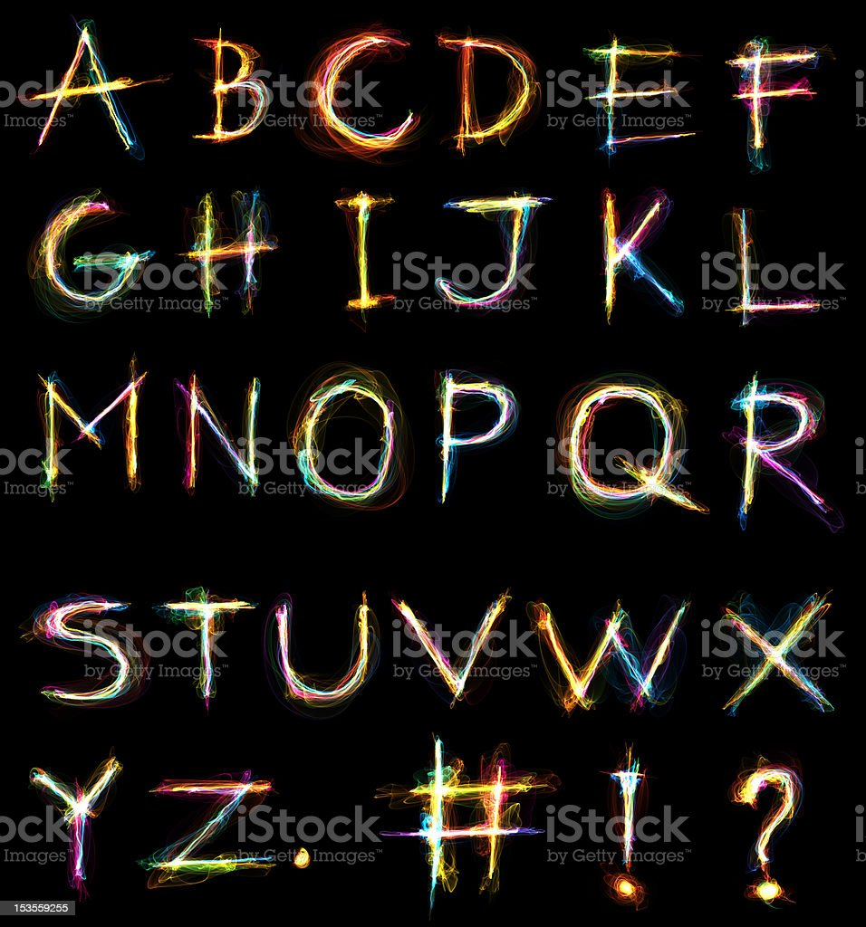 Glowing alphabet over a black background royalty-free stock vector art