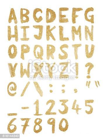istock Gold foil hand drawn alphabet 516144340