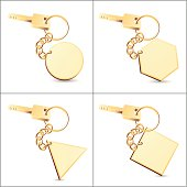 Gold key chains with blank tag. You can using Illustrator to add some words or symbol on the tag.