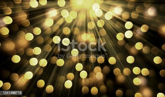 Golden bokeh and light rays background
