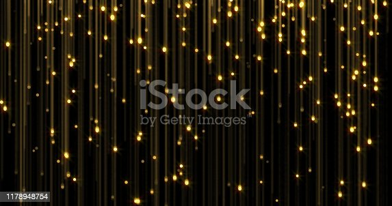 666540036istockphoto Golden glitter rain, bright light shine on gold threads. Glowing glittering lights curtain, shiny sparkling light and shimmer particles 1178948754