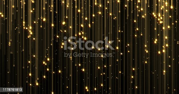 666540036istockphoto Golden rain, gold glitter particles falling. Glowing glittering magic lights. Christmas backdrop, shiny sparkling light threads in flowing loop, Gold particles with shimmer lights 1178761813