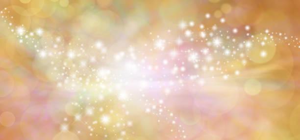 golden starry glitter warm toned bokeh background banner - anniversary backgrounds stock illustrations