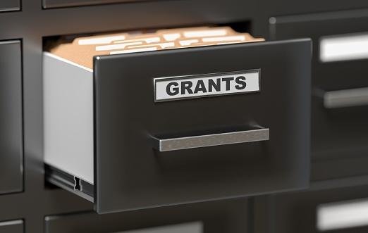 Grants folders and files in cabinet in office. 3D rendered illustration.