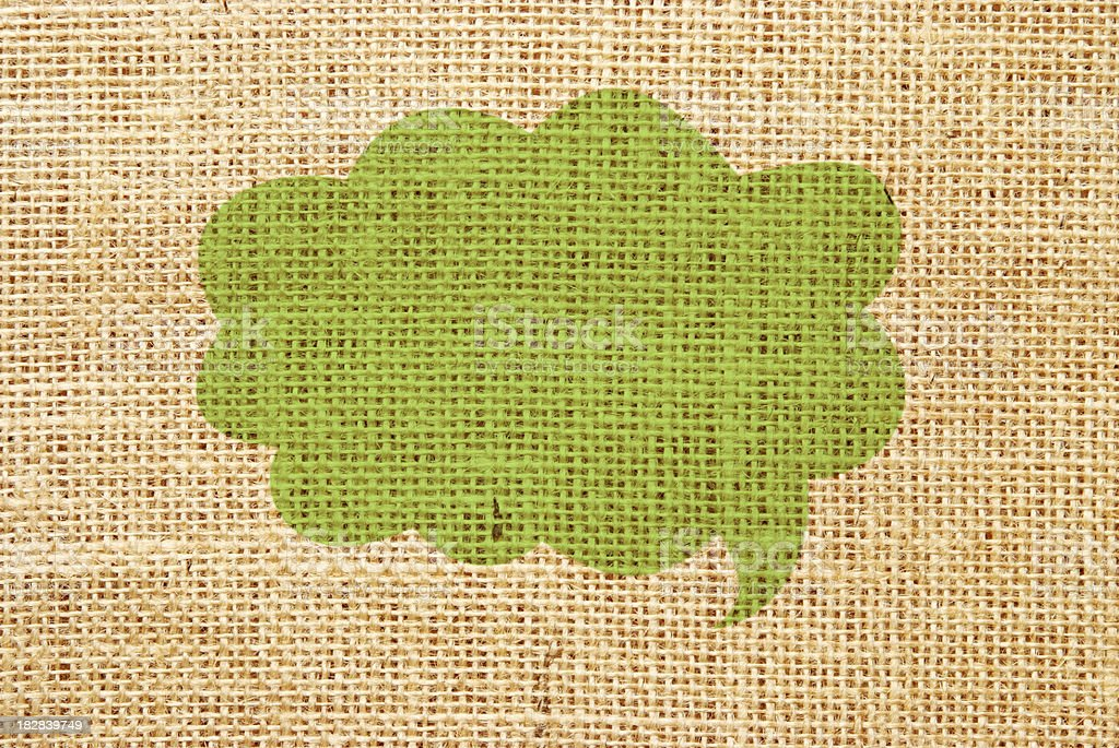 A green speech bubble with hessian fabric royalty-free a green speech bubble with hessian fabric stock vector art & more images of arts culture and entertainment