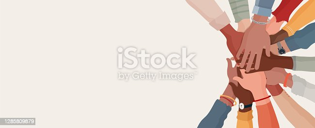 istock Group hands on top of each other of diverse multi-ethnic and multicultural people.Diversity people. Concept of teamwork community and cooperation.Diverse culture.Racial equality.Oneness 1285809879