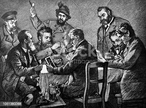 Group of adult men plays with passion in cards - 1888