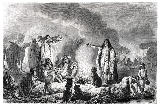 Group of patagones at fireplace at camp in Patagonia