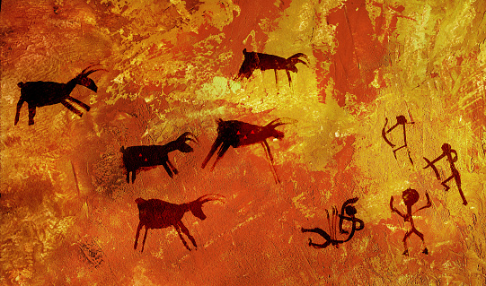 A group of primitive people hunts a herd of hoofed animals of deer and moose