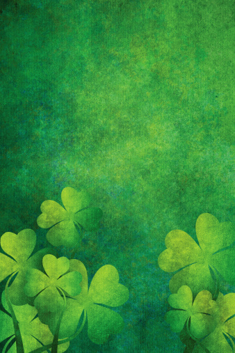 grunge background with four leaf clovers