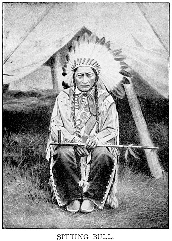 Halftone print of Sitting Bull, Hunkpapa Lakota chief, sitting with feather headress and peace pipe.