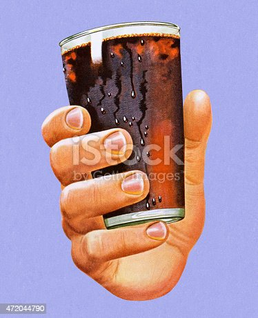 istock Hand Holding Glass of Cola 472044790