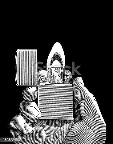istock Hand Holding Lighter 1328224232