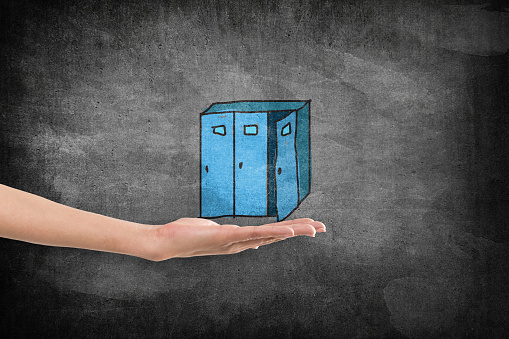 Hand holding storage cabinet
