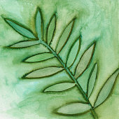 A silhouette of plant leaves painted on paper. There is a mottled grungy textured effect throughout the painting. The prominent colors are shades of green.