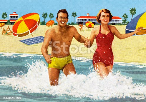 istock Happy Couple at the Beach 1003459158