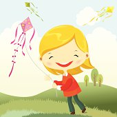 Happy girl playing kite in the field in spring