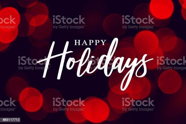 Happy Holidays Calligraphy With Red Lights Background — стоковая векторная графика и другие изображения на тему Ёлочная гирлянда