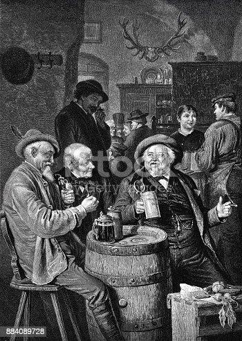 istock Happy men drinking beer in the restaurant 884089728
