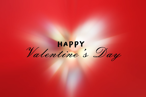 Happy Valentine's Day card with white shining heart on red background.
