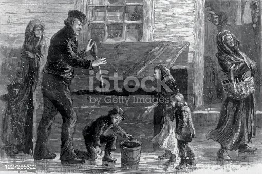Vintage engraving shows a boy picking up hard coal (or anthracite) from alongside a coal bin and putting it in a bucket, while a man stands by with a shovel. Unable to afford an efficient amount that would last more than a few days, the poor usually purchased only a small bucket of coal at a higher price from small businessmen who stocked up in the summer months.
