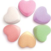 Vector illustration of six heart-shaped candies.