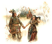 """Hiawatha and Minnehaha (Laughing Water) in a scene from Henry Wadsworth Longfellow's """"The Song of Hiawatha"""" (1855). """"From the wigwam he departed - Leading with him Laughing Water - Hand in hand they went together - Through the woodland and the meadow - Left the old man standing lonely - At the doorway of his wigwam"""". From """"Longfellow Pictures"""" by Herbert Dicksee, Miss M Dicksee and J Finnemore. Published by Ernest Nister, London and printed by E Nister in Nuremberg, Bavaria, 1891."""