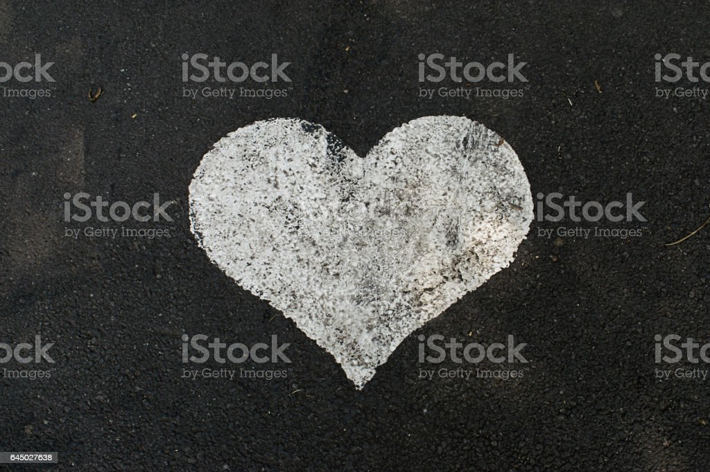 High Angle View of Painted Heart Shape on Asphalt vector art illustration
