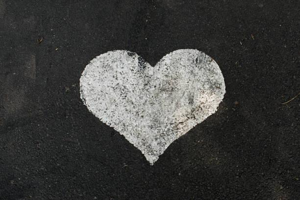 High Angle View of Painted Heart Shape on Asphalt vector art illustration