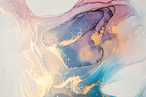 High resolution luxury abstract fluid art painting in alcohol ink technique, mixture of blue and purple paints. Imitation of marble stone cut, glowing golden veins. Tender and dreamy design.