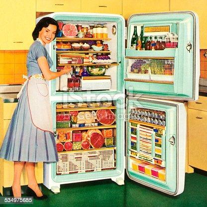 istock Homemaker Showing a Full Refrigerator 534975685