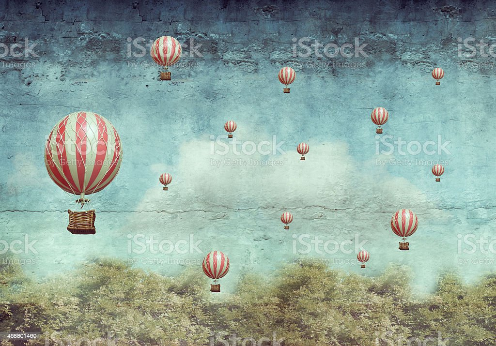 Hot air ballons flying over a forest vector art illustration