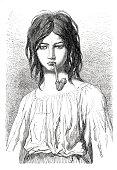 istock Hungarian gypsy young woman smoking pipe 1870 1307945591