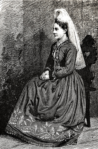 Icelandic woman in traditional dress, sitting on chair, side view