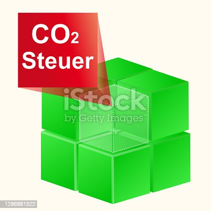 istock 3D illustration 3D green cubes with CO2 tax label 1286881522