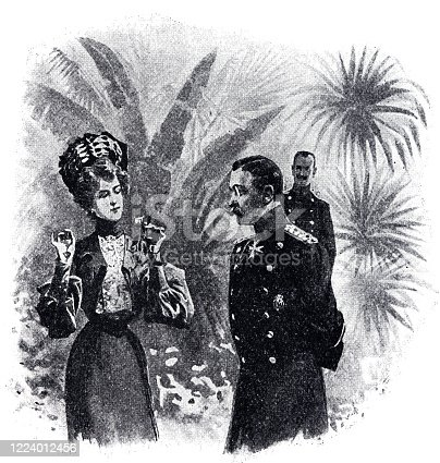 istock In a palm-tree setting: Elegant woman talks to an officer 1224012456