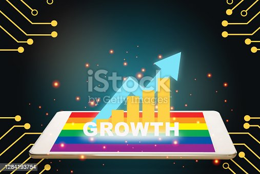 Growth graph on computer digital tablet with rainbow colourful screen on technology theme background
