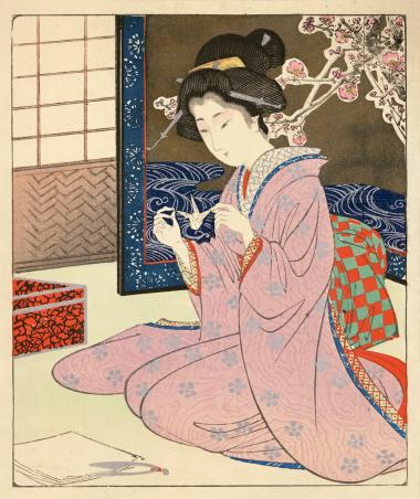 Japanese Woodblock of a female making Origami
